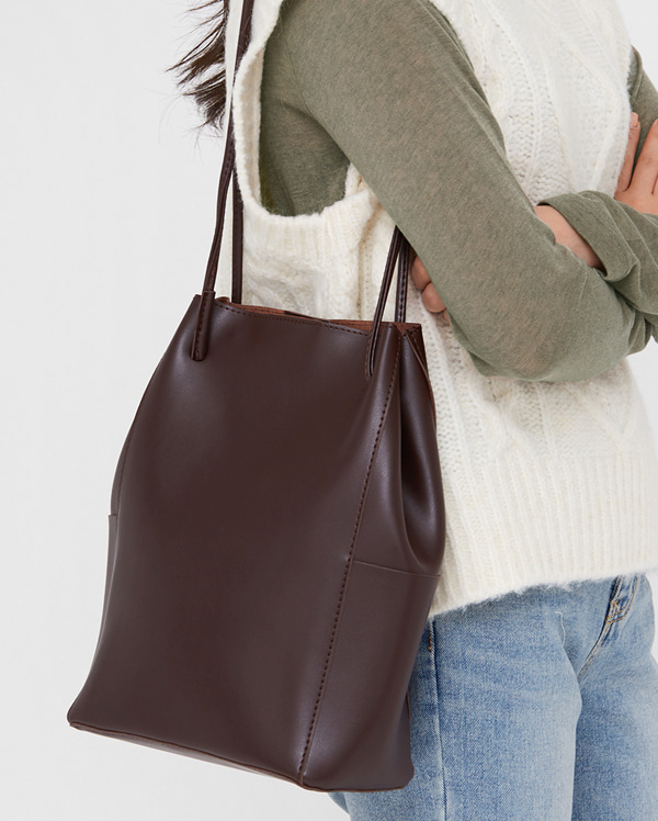 angled up leather bag